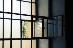 Window in the prison cell. Lattices on the window in the room. Deprivation of liberty.