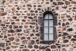 Window in the stone wall of the Vyborg Castle front view, Vyborg, Leningrad Oblast, Russia