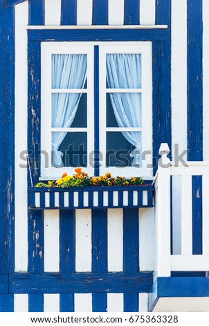Window in typical small wooden house with colorful stripes in Costa Nova. Aveiro. Portugal.