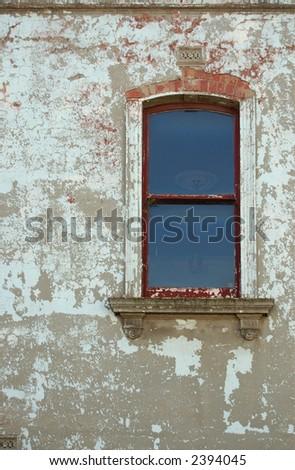 window in wall of peeling paint