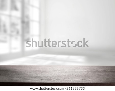window in white room and desk space of dark color