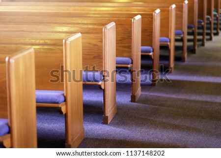 Window light is shing on rows of empty church pews in a Church Sanctuary without any people in it. #1137148202