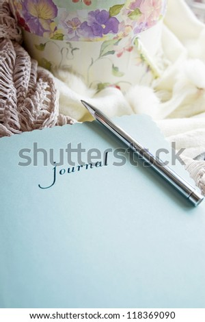 window light on blue journal book with sweet floral box and scarf