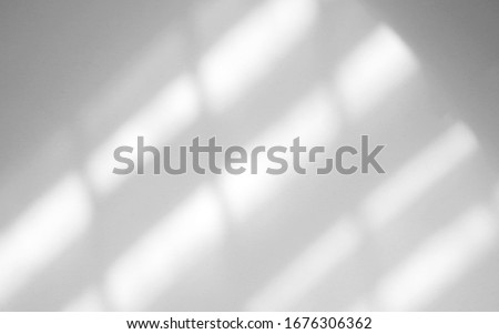 Photo of  Window natural shadow overlay effect on white texture background, for overlay on product presentation, backdrop and mockup