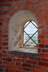 Window niche on a brick wall in a tower