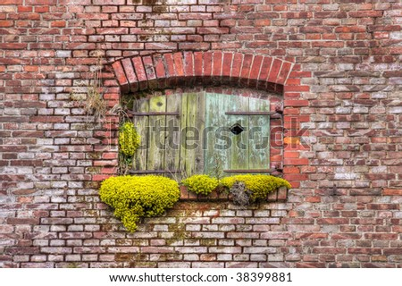 window of an old house made of bricks - stock photo