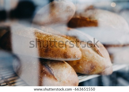 Window of bakery with fresh breads view from the street.