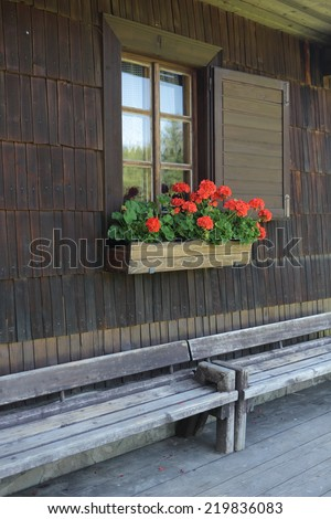 Window of historical timbered building decorated with flowers, Solan, National Protected Area Beskydy, Czech republic, Europe