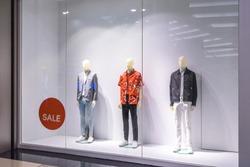 window of luxury clothing store