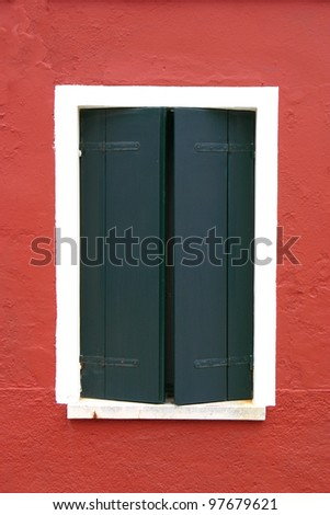 Window of one of the colored houses in Burano - Venice - Italy