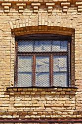 Window on old brick wall
