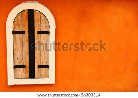Window on orange cement wall - stock photo