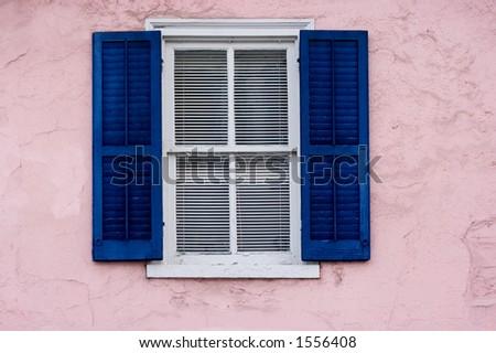 Window on pink wall - stock photo