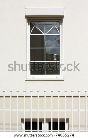 window on the white  wall