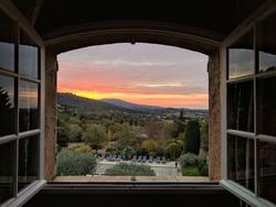 Window open on sunrise in Provence, France