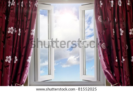 Window open with a view to sky and sun