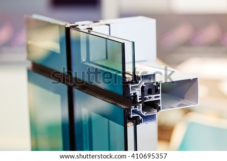 Window profile cut of with metal, glass and insulation stock photo