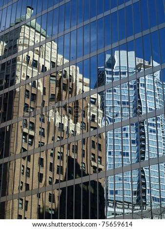 Window reflection from new city of modern technology in downtown Vancouver - stock photo