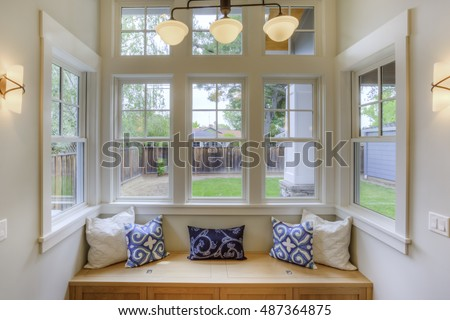 Window Seat with a view to the yard and large windows  #487364875