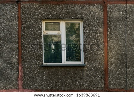 Window shabby time. A shot of a residential window. Old window frame. Prefabricated house in Russia. Window in the living room.