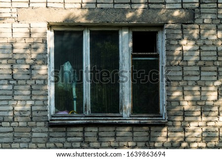 Window shabby time. A shot of a residential window. Old window frame. Prefabricated house in Russia. Window in the living room
