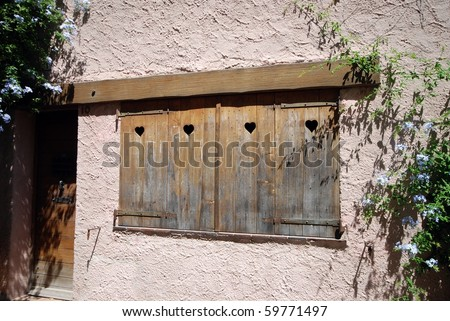 window shutter with heart shape in provence, france