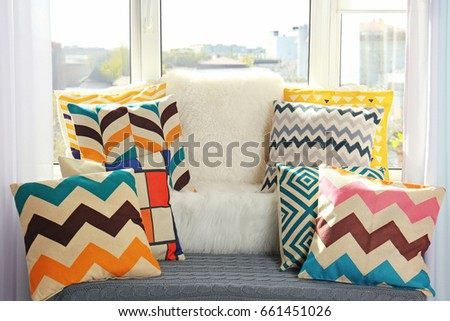Window sill with stylish pillows indoors
