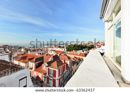 Window view to roofs of Lisbon.