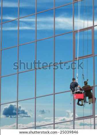Window washer at work and reflect the sky in the windows