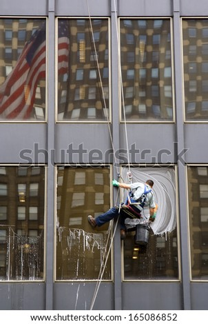 Window Washer with American Flag Reflection