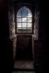 Window with a grid and skies in a castle