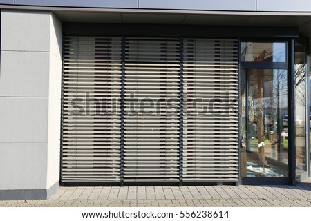 Window with blind, exterior shot #556238614