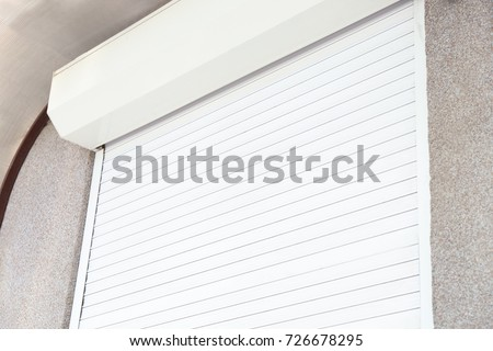 Window with closed roller shutter, closeup