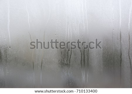 Window with condensate or steam after heavy rain, large texture or background