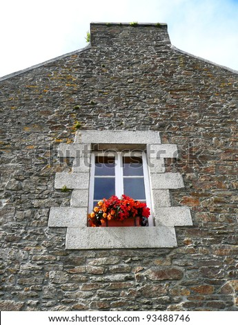 Window with flowers in Brittany