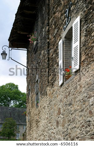 Window with Geraniums - side wall of a picturesque Limousin limestone house