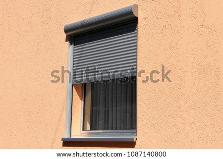 Window with porch roller shutter, exterior shot
