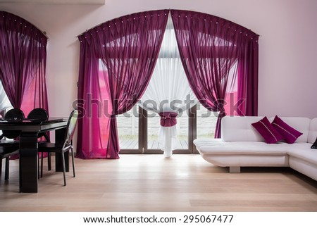 Window with rose curtains in modern interior