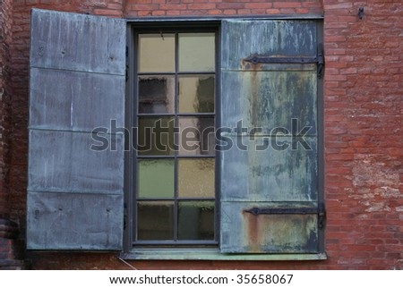 Window with rusty panels