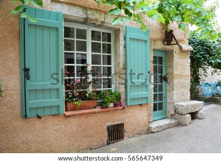 Window with shutters and door in provence style with original lantern