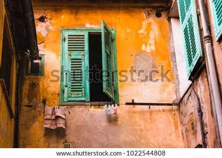 window with shutters on orange...