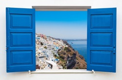 Window with view over the village of Oia at the Island Santorini, Greece