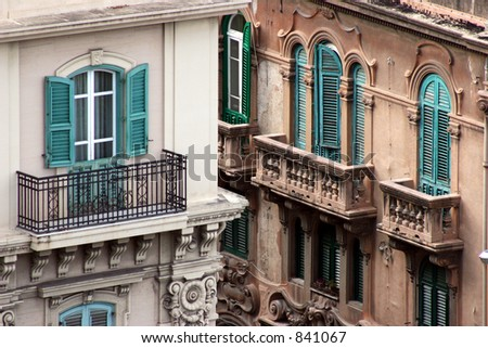 Windows and balconies in Messina, Italy.