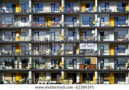 Windows and balconies of a multiroom apartment house of mass building