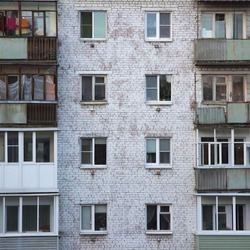 Windows and balconies of the old brick apartment building in Russia