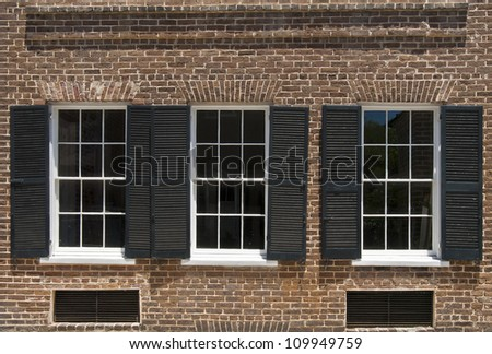 Windows and brick work of a townhouse built in the nineteenth century.