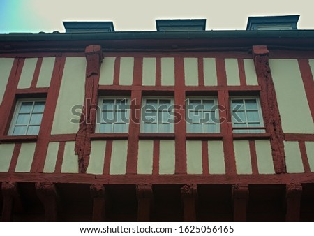 Windows and facade on medieval house in Dinon, France