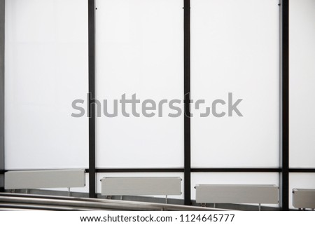 Windows and radiators near the floor. Modern architecture, minimal interior design or abstract geometric background with parallel lines and rectangular frames for text or posters on engineering issues