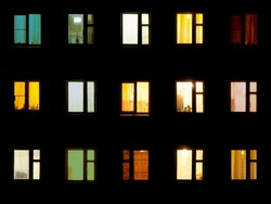 Windows at night. House building lights seamless background