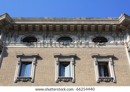 Windows in a beautiful palace into the center of Rome